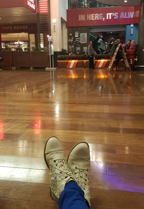 Sitting on the floor at St Dewi's shopping centre